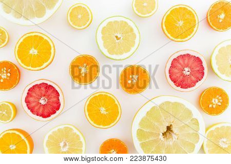 Citrus fruits pattern made of lemon, orange, grapefruit, sweetie and pomelo on white background. Flat lay, top view. Fruit's background