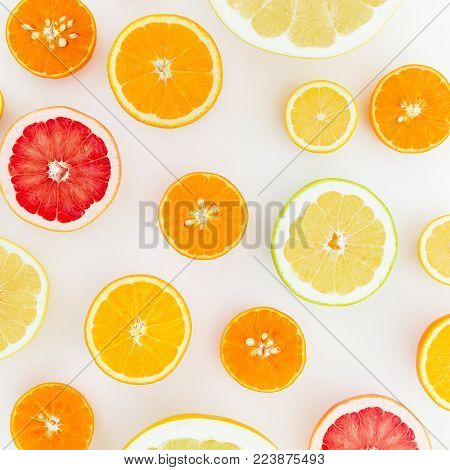 Fruit's background. Pattern of lemon, orange, grapefruit, sweetie and pomelo on white background. Flat lay, top view.