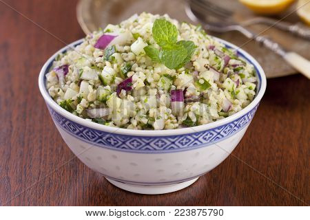 Tabbouleh made from bulgar wheat, mint, coriander, cucumber, and red onion.
