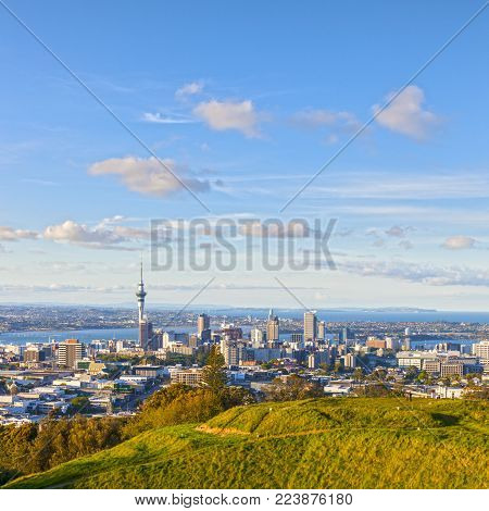 Auckland, New Zealand, from the volcano Mount Eden, the crater rim is in the foreground.