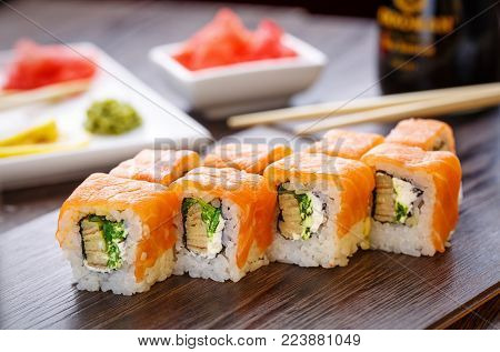 Beautifully Decorated Sushi On A Wooden Board. Sushi Is The Traditional Asian Food. Roll Of Sushi Pr