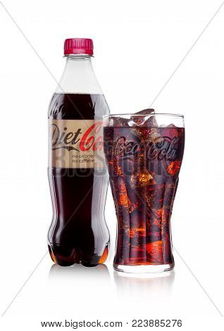 LONDON, UK - JANUARY 24, 2018: Bottle and glass of Diet No Caffeine Coca-Cola on white Background. Coca-Cola is one of the most popular soda products in the world.