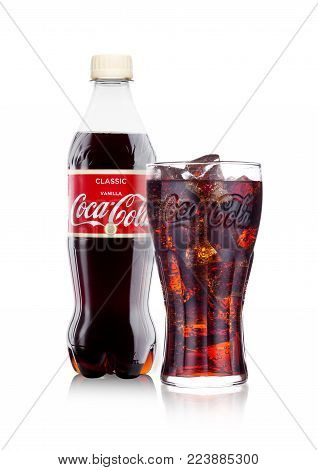 LONDON, UK - JANUARY 24, 2018: Bottle and glass of Vanilla Coca-Cola on white Background. Coca-Cola is one of the most popular soda products in the world.