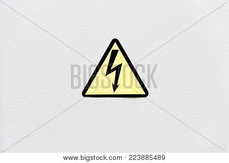 Vintage looking Signal of danger of death by electrocution following an electric shock a symbol of high voltage on a metal panel painted in white