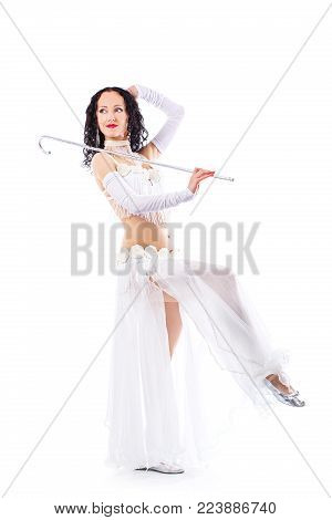 Sensual arabic girl belly dancer dancing in studio. Belly dance movement in action