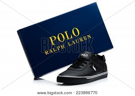 LONDON, UK - JANUARY 24, 2018: Black color Ralph Lauren Polo sport shoes with blue on white background.