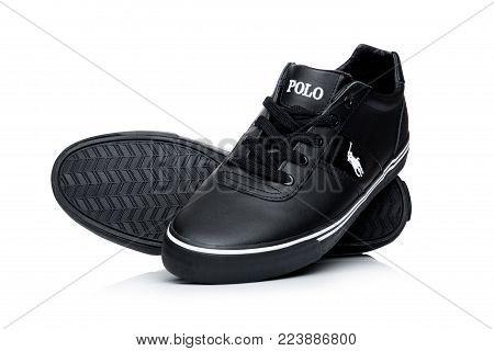 LONDON, UK - JANUARY 24, 2018: Black color Ralph Lauren Polo sport shoes on white background.