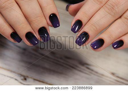 Manicure - Beauty treatment photo of nice manicured woman fingernails. Feminine nail art with nice glitter, pink and white nail polish.