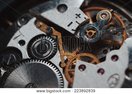 open clockwork, gears. Old vintage clock mechanism working, closeup shot with soft focus. Antique pocket watch, macro of mechanism time going fast.