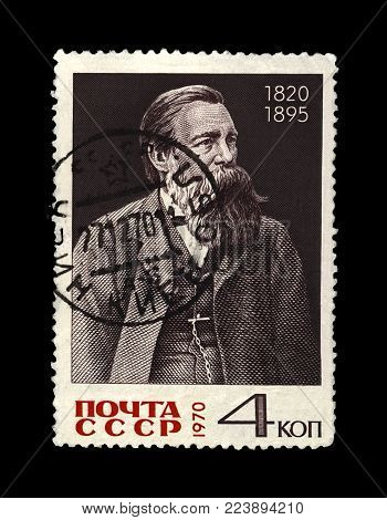 MOSCOW, USSR - CIRCA 1970: canceled postal stamp printed in the USSR shows Friedrich Engels (1820-1895), famous politician leader, circa 1970. Vintage stamp isolated on black background.