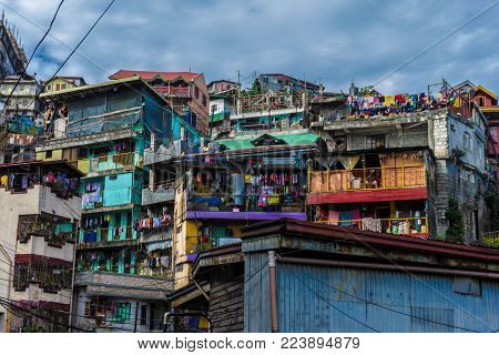 Color image of Baguio City, Philippines taken 12JAN2014.  Image depicts inner city architecture in a third world setting to reflect the presence of poverty and community