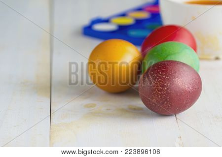 Colored Easter eggs on a white background. Easter background. Easter eggs.