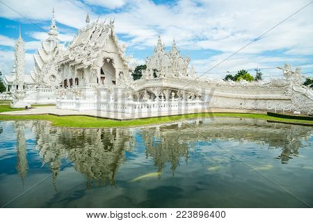Chiangrai, Thailand - August 14 2016: 'The White Temple' in Chiang Rai, otherwise known as 'Wat Rong Khun' in Thai, The bizarre brainchild of Thai National Artist Chalermchai Kositpipat.