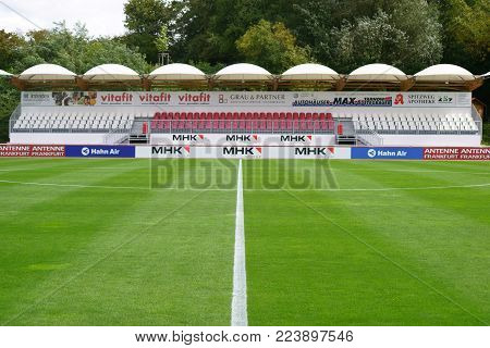 DREIEICH, GERMANY - SEPTEMBER 09: The covered grandstand of the Hahn Air sports park with advertising boards and banners on September 09, 2017 in Dreieich.