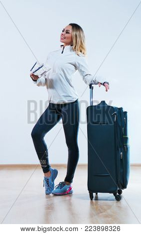 Young woman traveling with bag and tickets to airplane