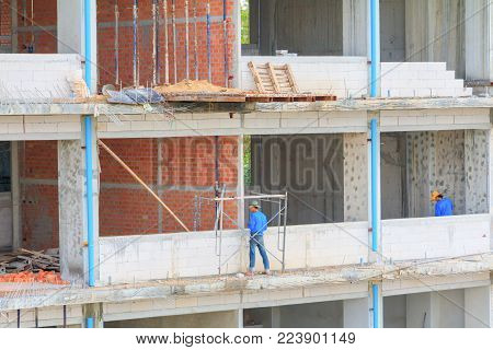 construction workers building develop of housing at laborer work outdoor.