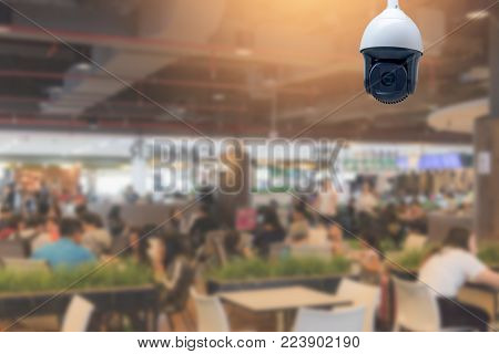 Modern CCTV security camera in the food court