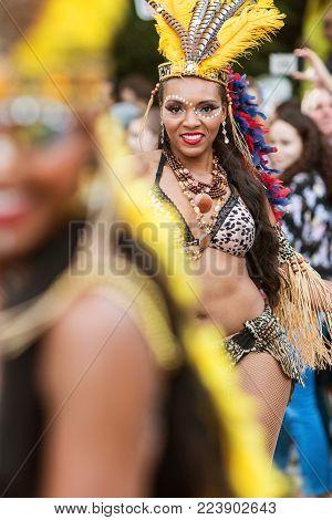 ATLANTA, GA - OCTOBER 2017:  A Brazilian dancer struts with confidence as she walks in the Little Five Points Halloween Parade in Atlanta, GA on October 21, 2017.