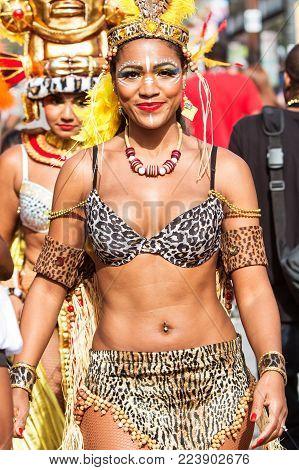 ATLANTA, GA - OCTOBER 2017:  A Brazilian dancer walks with confidence as she takes part in the Little Five Points Halloween Parade in Atlanta, GA on October 21, 2017.