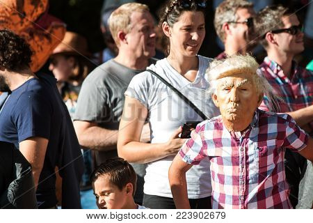 ATLANTA, GA - OCTOBER 2017:  A kid wears a Donald Trump mask at the Little Five Points Halloween Parade in Atlanta, GA on October 21, 2017.