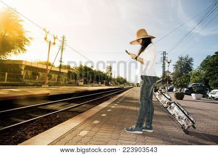 Pretty Asian Women Traveler Walk And Looking The Tablet Drag And Drop Luggage And Wait A Train At Ra