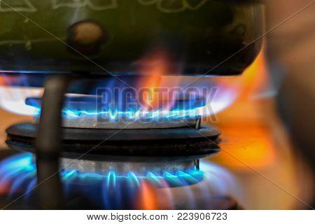Cast iron pot on a burning gas stove top