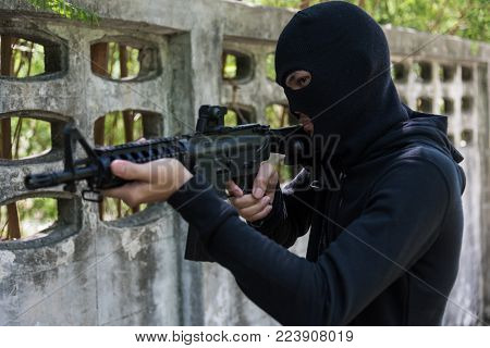 Robber Assassin Crime With Hood Points The Gun