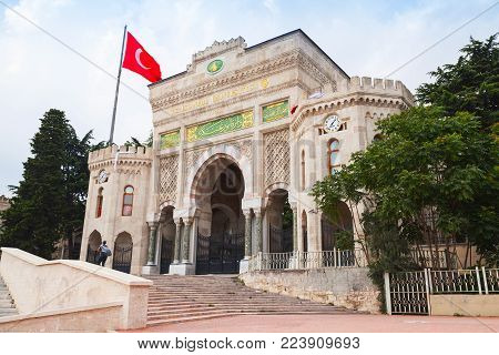 Istanbul, Turkey - June 28, 2016: Main entrance gate of Istanbul University. Ordinary people walk nearby