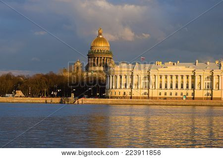 Saint Isaacs Cathedral and the Constitutional Court building on a sunny April evening. Saint-Petersburg, Russia