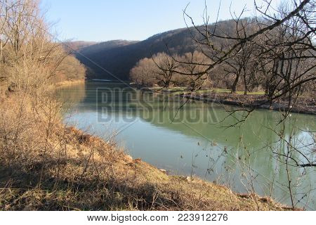 Nice view of the mountain river. The mountain river flows rapidly among the Carpathian mountains and  forests. Beautiful landscape with speed mountainous river in the forest of Carpathian mountains.