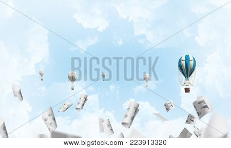 Colorful aerostats flying among paper documents and over the blue cloudy sky. 3D rendering.