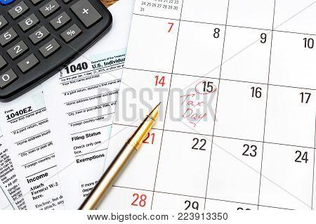 Calendar with calculator on tax forms. Tax pay deadline.
