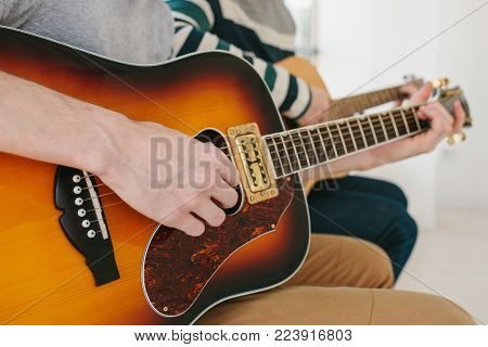 Learning to play the guitar. Music education and extracurricular lessons. Hobbies and enthusiasm for playing guitar and singing songs. To have fun. poster