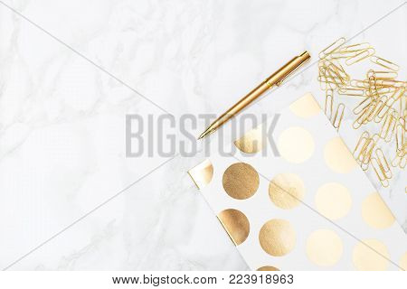 Stationery golden color on the table. Education concept