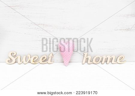 Home decor. Wooden inscription sweet home on a wooden background