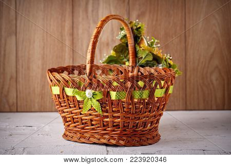 Basket Decorated Handmade. Festive Basket Decorated With Flowers On Wooden Background.