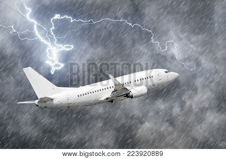 Airplane approach at the airport landing in bad weather storm hurricane rain llightning strike.