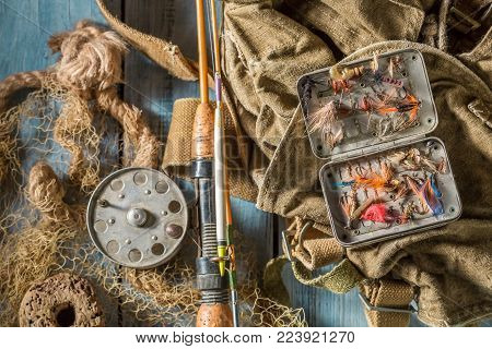 Fishing Tackle With Fishing Flies And Rods