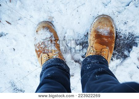 winter shoes in snow, close-up .Close up image of foot
