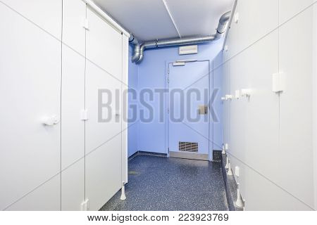 an public toilet and an shower in an public building