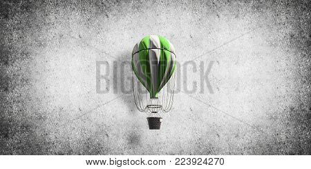 Colorful aerostat flying against gray concrete wall. 3D rendering.
