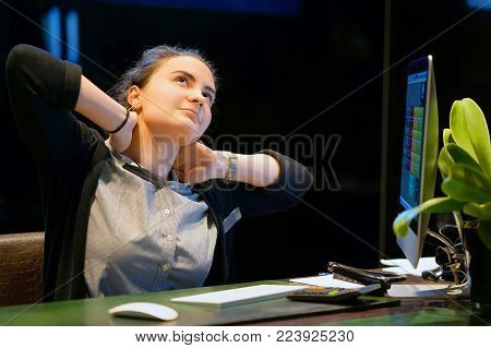 Tired Neck. Hotel manager. A woman-reception Suffering From Neck Pain. Female Feeling Tired, Exhausted, Stressed. Girl Massaging Painful Neck With Hands. Body And Health Care Concept.