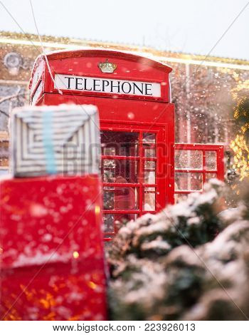Red Telephone Box In The Snow. Telephone Booth In Winter. Christmas Tree, Gifts, Phone Booth.