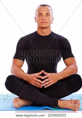Portrait of joga trainer meditation in studio