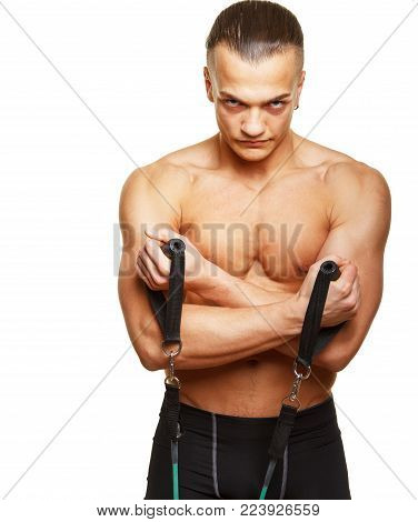 Fitness man doing exercises with expander on white background