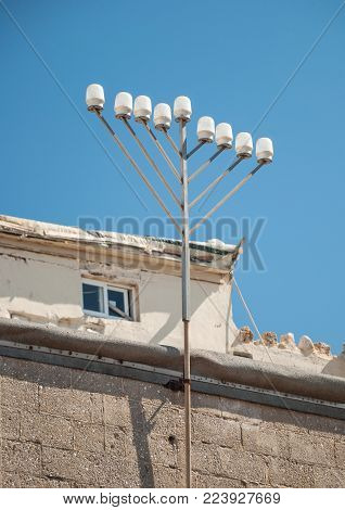 Electric fuse on the roof of an old house in Tel Aviv