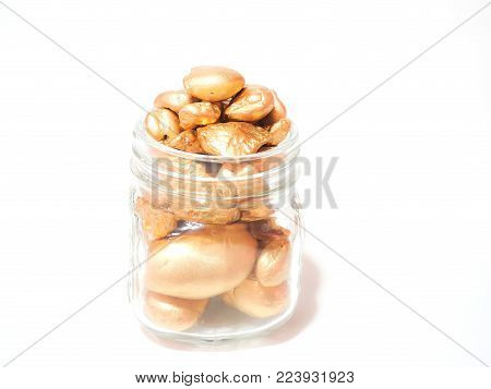 jar glass full of gold nuggets concept for saving , finance concept