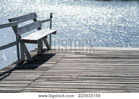 Wooden chairs and pond for relax time at home