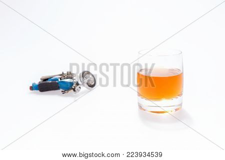 Do not drink and drive. Motorcycle next to a glass of brandy