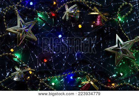 Decorations of a Christmas tree in the shape of stars on a black and white background. The included electric garland. Christmas lights